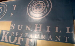 Logotarra siirtokalvolla Sun Hill Restaurant